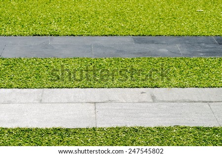 pathway in the green grass - stock photo