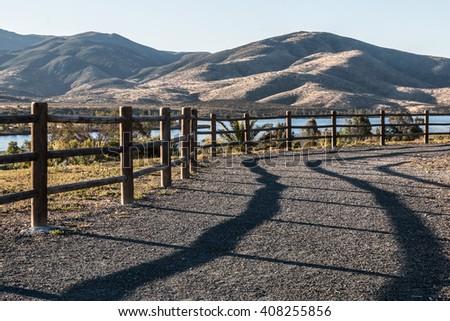 Pathway to lake and mountain range at Mountain Hawk Park in Chula Vista, California.  - stock photo