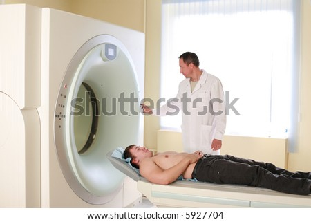 Patient and doctor ready to do CAT scan with CT scanner. - stock photo
