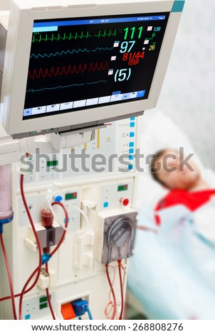 Patient at dialysis (blood purification medical procedure) with cardiogram monitor