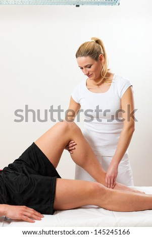 Patient at the physiotherapy doing physical exercises with his therapist