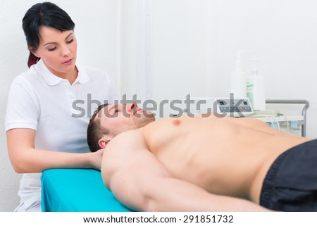 Patient at the physiotherapy getting medical massage from therapist - stock photo