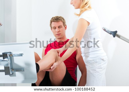 Patient at the physiotherapy making physical exercises with his therapist