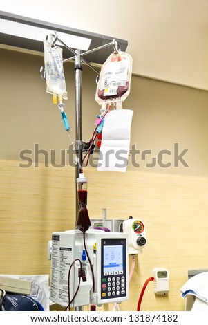 Patient Blood Transfusion and Saline Solution IV in Hospital Room - stock photo