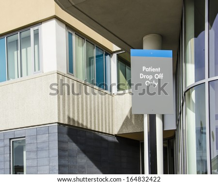 Patient Drop-Off sign outside hospital entrance - stock photo