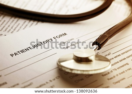 Patient history form and stethoscope. Medical concept. - stock photo