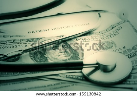 Patient history, stethoscope and dollars. Medical concept. - stock photo