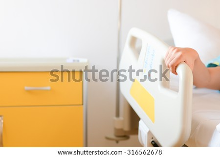 patient holding his hand on hospital stock photo edit now