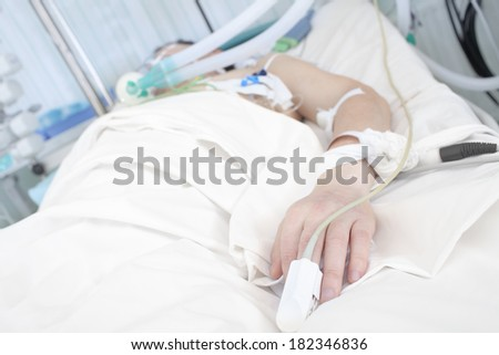 Patient in bed. Hand in focus