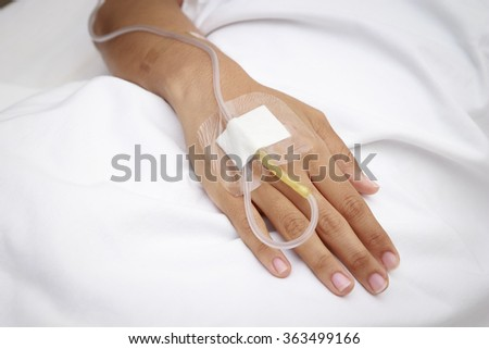 patient in hospital with saline intravenous (iv) - stock photo