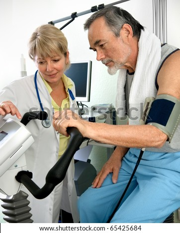 Patient is being observed by doctor - EKG test - stock photo