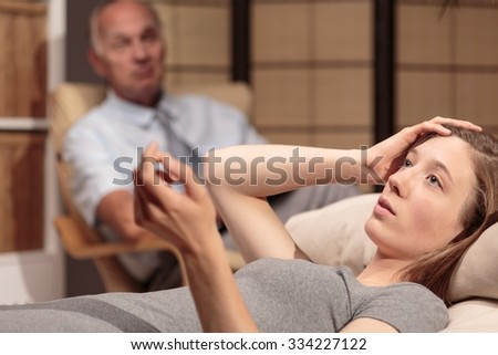 Patient is trying to remember an important aspect of her past - stock photo