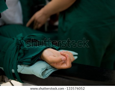 patient lying on bed waiting for operation. - stock photo
