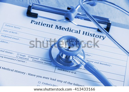 Patient medical history on a clipboard with stethoscope and a blue ballpoint pen, putting on a physician's table. Blank form waiting to be filled and reviewed / examined by nurse / clinical assistant. - stock photo