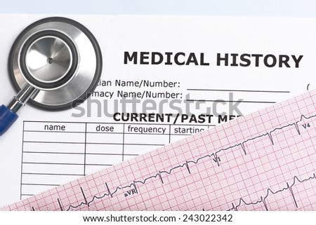 Patient medical history with electrocardiograph and stethoscope. - stock photo