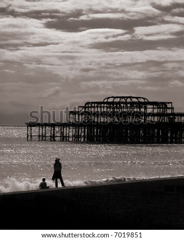 Patient mother on Brighton beach - stock photo