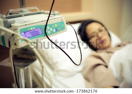 Patient on blood transfusion operation in hospital - stock photo