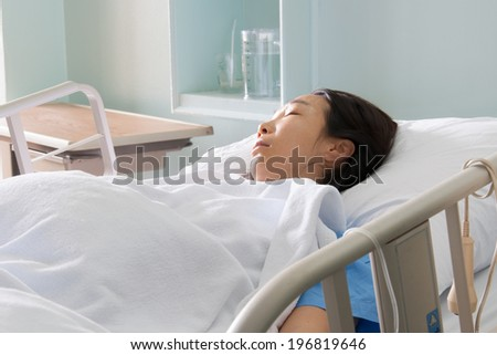 Patient on gurney in hospital room. - stock photo