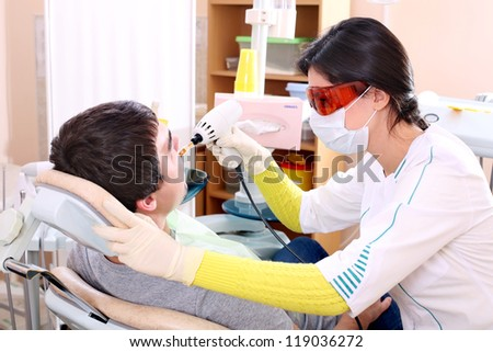 Patient on reception at the dentist - stock photo