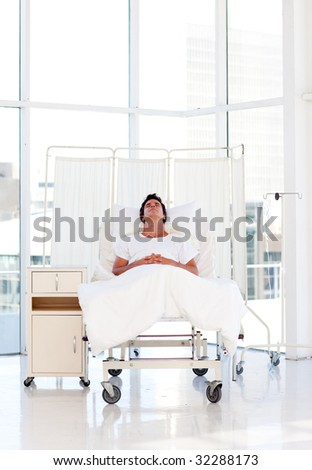 Patient recovering in bed in a hospital
