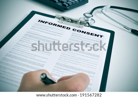 patient signing an informed consent in a doctors office - stock photo