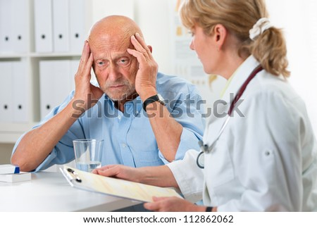 Patient tells the doctor about his health complaints - stock photo