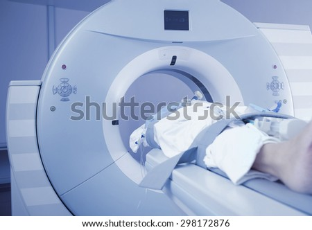 Patients screening on CT scanner - stock photo