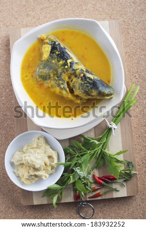 Patin silver catfish head with durian paste and chillies. Famous food in Malaysian traditional dishes.