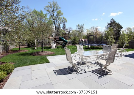 Patio and back yard of suburban home - stock photo