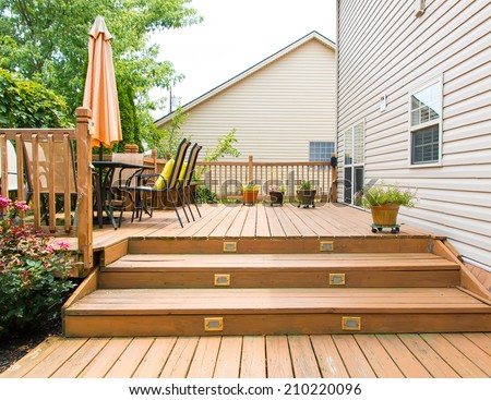 Patio and garden of family home at summer - stock photo