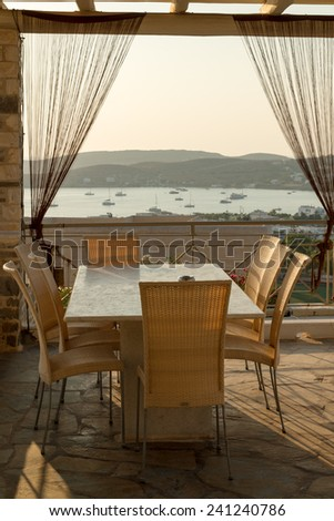 Patio at sunset on the Greek island of Paros - stock photo