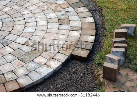Patio bricks installation - stock photo