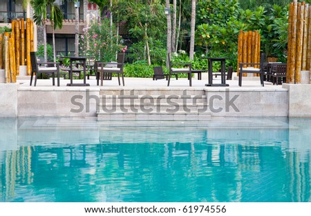 patio by the swimming poolside - stock photo