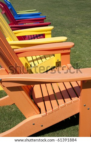patio chairs sitting on green grass outside - stock photo