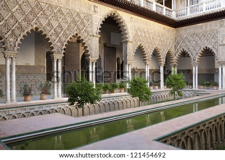 Patio de las Doncellas in Real Alcazar, Seville. One of the most beautiful landmarks in Real Alcazar Palace in Seville, Spain - stock photo