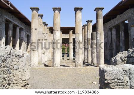 Patio, decorated classic antique columns in a villa in Pompeii - stock photo