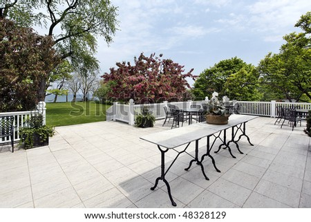 Patio of luxury home with lake view - stock photo