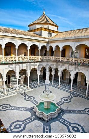 Patio Principal of La Casa De Pilatos, Seville In Spain. The building is a precious palace in mudejar spanish style. - stock photo