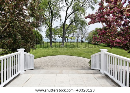Patio steps of luxury home with lake view - stock photo