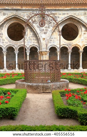 Patio surrounded by the cloister of Fontfroide Abbey, Languedoc-Roussillon, France - stock photo