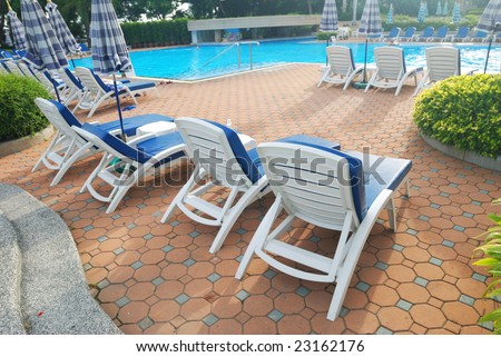 Patio with chaise lounges near luxury hotel - stock photo