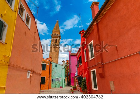 Patio with colorful houses and church on the famous island Burano, Venice, Italy - stock photo