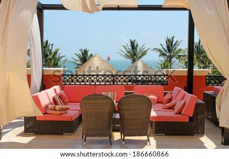 Patio with rattan sofa  - stock photo