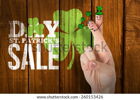 Patricks Day fingers against overhead of wooden planks