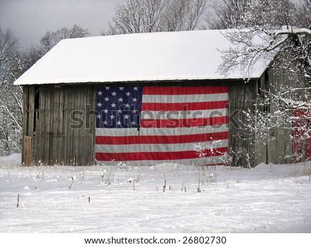 patriotic barn in winter - stock photo