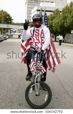 Patriotic bicyclist dressed in American Flag at early vote for change Presidential rally, October 29, 2008 at Halifax Mall, Government Complex in Raleigh, NC