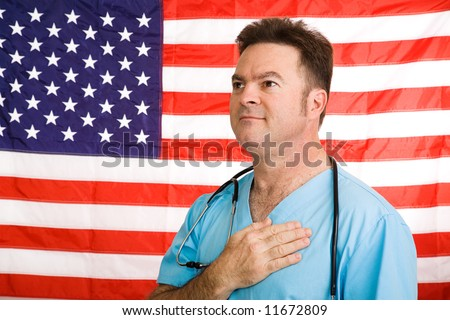 Patriotic doctor saying the Pledge of Allegiance to the American flag.  Photographed in front of flag, not a composite image. - stock photo