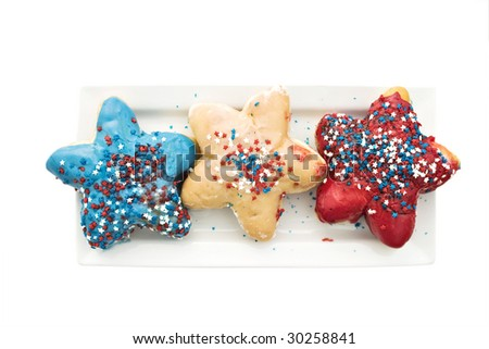 Patriotic donuts isolated on white with shallow depth of field and clipping path. Perfect for the Fourth of July holiday.