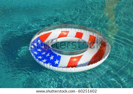 Patriotic Pool float / pool ring in swimming pool - stock photo