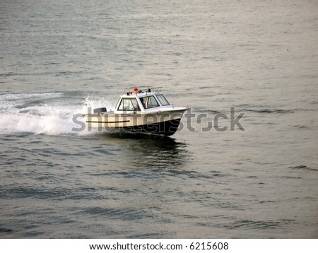 Patrol Boat -- a harbor police boat speeding through the water